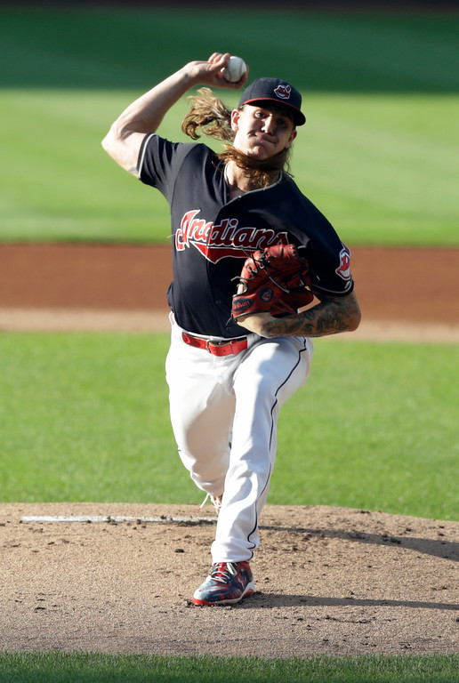 . Cleveland Indians starting pitcher Mike Clevinger delivers in the first inning of a baseball game against the Cincinnati Reds, Monday, July 9, 2018, in Cleveland. (AP Photo/Tony Dejak)