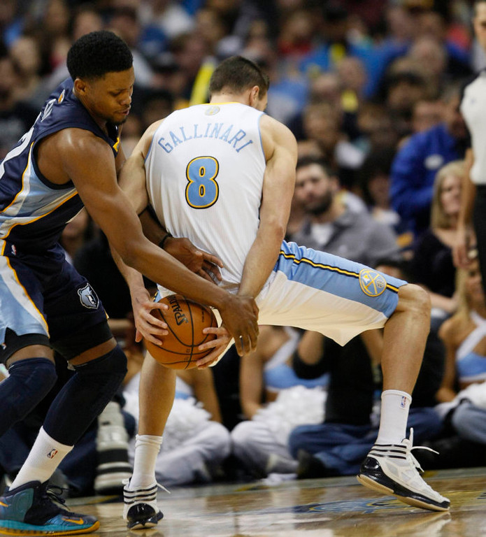 . Memphis Grizzlies forward Rudy Gay (L) tries to get the ball from Denver Nuggets forward Danilo Gallinari (8) in the third quarter of their NBA basketball game in Denver December 14, 2012.   REUTERS/Rick Wilking