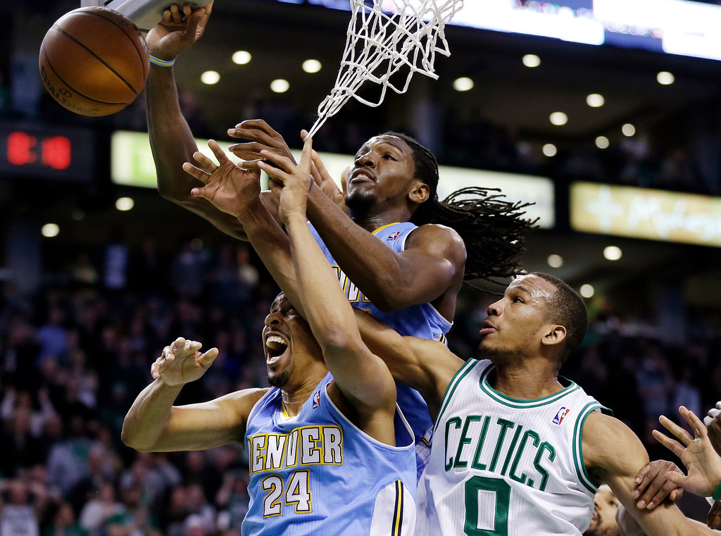 . Boston Celtics guard Avery Bradley (0) competes for a loose rebound with Denver Nuggets point guard Andre Miller (24) and forward Kenneth Faried, center, during the fourth quarter of an NBA basketball game in Boston, Sunday, Feb. 10, 2013. The Celtics won 118-114 in triple-overtime. (AP Photo/Elise Amendola)