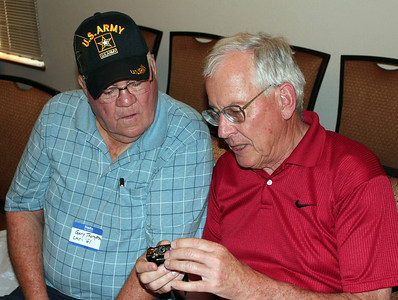 Michael R. Hoevet (right) appears to be sharing state secrets wih Gary Thompson (CHS '61).