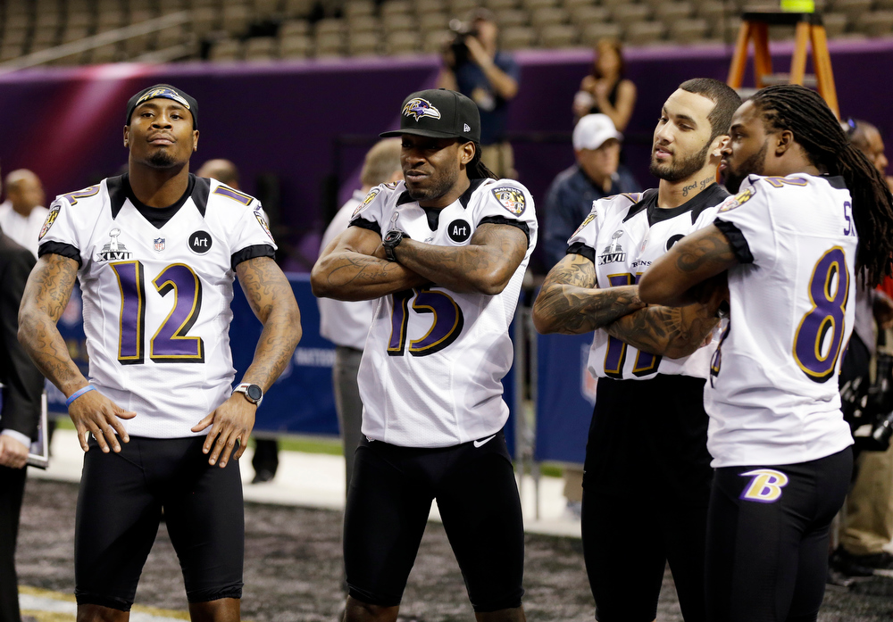 Description of . Baltimore Ravens wide receiver Jacoby Jones (12), LaQuan Williams (15), Tommy Streeter (11) and BTorrey Smith during media day for the NFL Super Bowl XLVII football game Tuesday, Jan. 29, 2013, in New Orleans. (AP Photo/Pat Semansky)