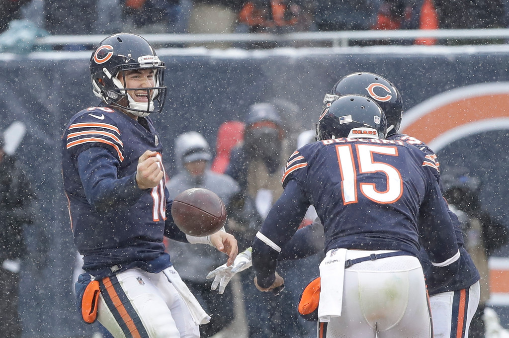 . Chicago Bears quarterback Mitchell Trubisky (10) celebrates his rushing touchdown against the Cleveland Browns in the second half of an NFL football game in Chicago, Sunday, Dec. 24, 2017. (AP Photo/Charles Rex Arbogast)