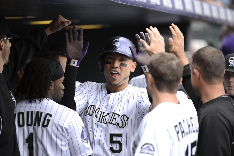 . Colorado Rockies Carlos Gonzalez (5) gets high fives in the dugout after scoring in the first inning against the San Diego Padres April 7, 2013 at Coors Field. (Photo By John Leyba/The Denver Post)