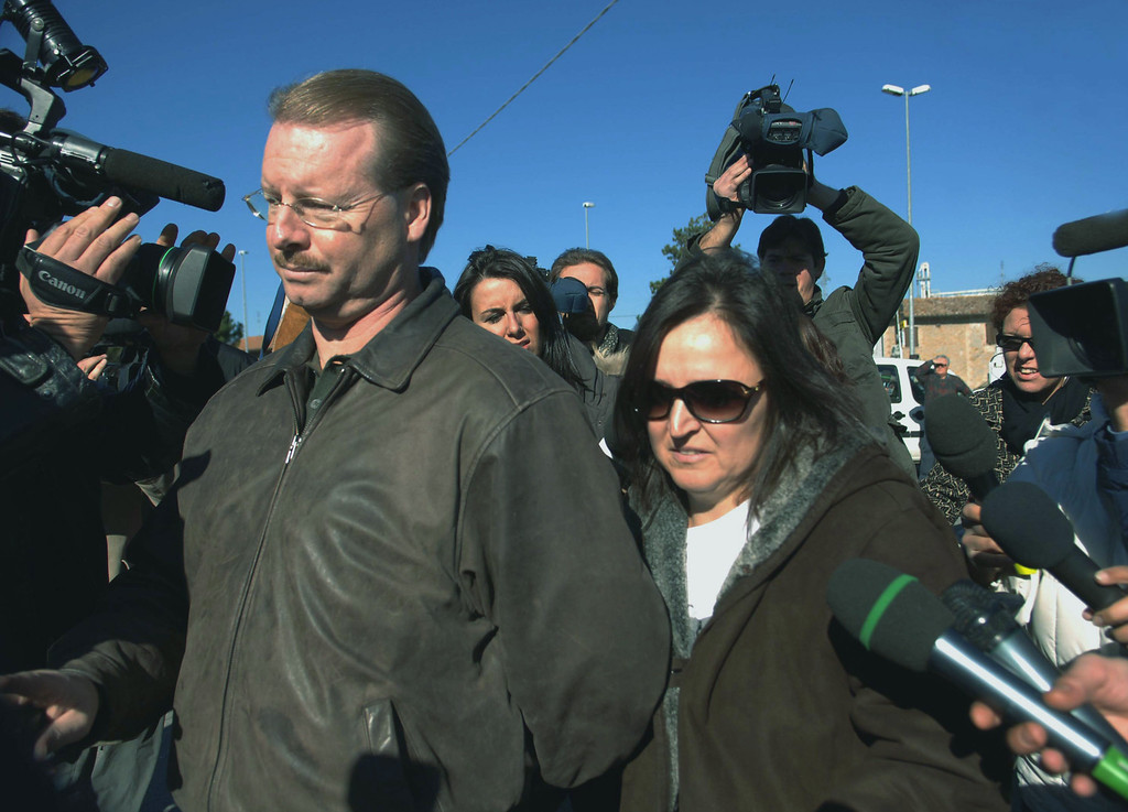 . Edda Mellas, right, the mother of U.S. student Amanda Marie Knox - who is suspected in the murder of her British apartment mate -, is approached with her partner  by journalists outside the jail where her daughter is held, in Perugia central Italy, Wednesday Nov. 14, 2007.   (AP Photo/Leonetto Medici)