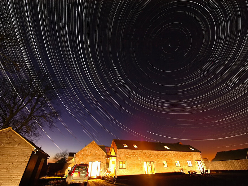 Startrails above the Humpage household. Taking advantage of the clear evening, this was taken on the evening/morning of March 6/7th 2010. I set the camera on tripod at 1900hrs and left shooting one exposure every 15s through till next morning. 2500 images stacked and flattened to produce the star trail. Taken with Olympus E3 and 7-14mm lens. Light sky bottom left was sunset and orange glow bottom right is the shocking city light pollution.