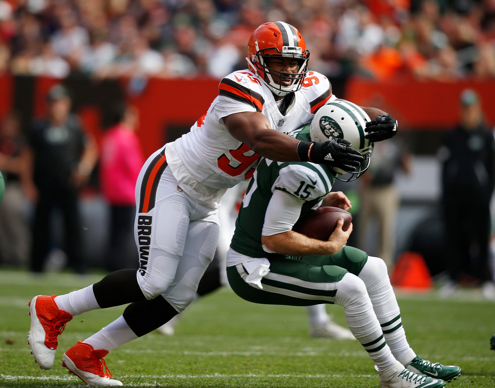 . Cleveland Browns defensive end Myles Garrett, left, sacks New York Jets quarterback Josh McCown during the first half of an NFL football game, Sunday, Oct. 8, 2017, in Cleveland. (AP Photo/Ron Schwane)
