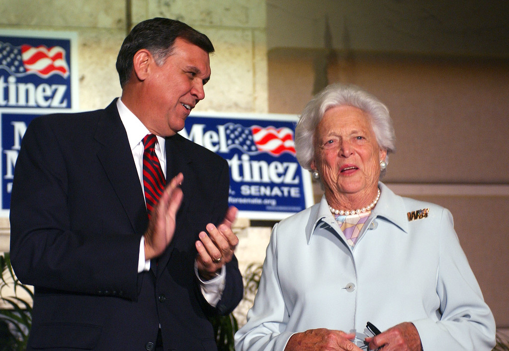 . Former First Lady Barbara Bush, right, receives applause from supporters after speaking on behalf of Republican U.S. Senate candidate Mel Martinez, left, during a fundraising dinner in Orlando, Fla., Tuesday, Oct. 12, 2004. (AP Photo/Phelan M. Ebenhack)