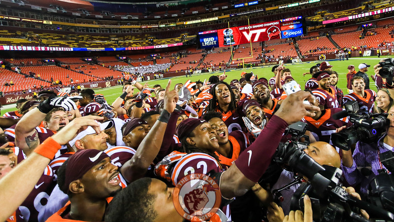 The Hokies pose for a selfie as they wait for the trophy presentation. (Mark Umansky/TheKeyPlay.com)