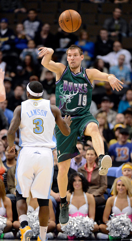 . DENVER, CO. - FEBRUARY 05: Beno Udrih (19) of the Milwaukee Bucks passes off over Ty Lawson (3) of the Denver Nuggets during the first quarter February 05, 2013 at Pepsi Center. The Denver Nuggets take on the Milwaukee Bucks in NBA action. (Photo By John Leyba/The Denver Post)