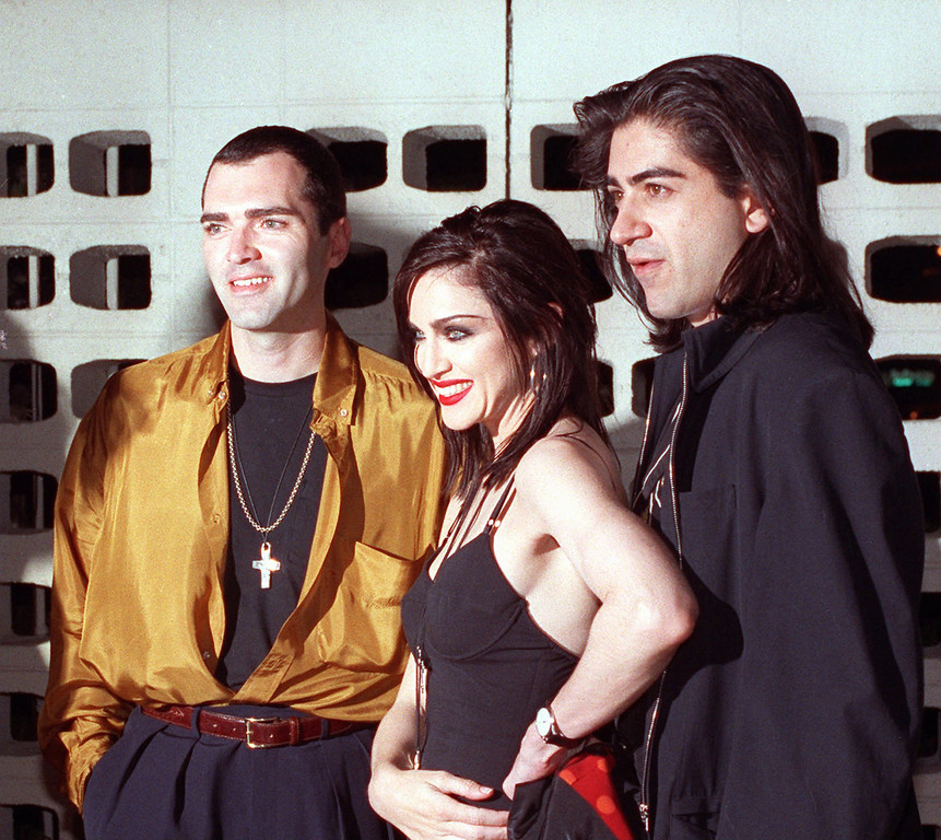 """. Madonna poses with her brother, Christopher Ciccone, left, and director Alek Keskishian following the premiere showing of Madonna\'s newest film, \""""Truth or Dare,\"""" in the Hollywood section of Los Angeles on May 7, 1991.  The film, directed by Keskishian, is an intimate look at Madonna during her Blond Ambition tour.  Her brother was the art director of the tour. (AP Photo/Julie Markes)"""