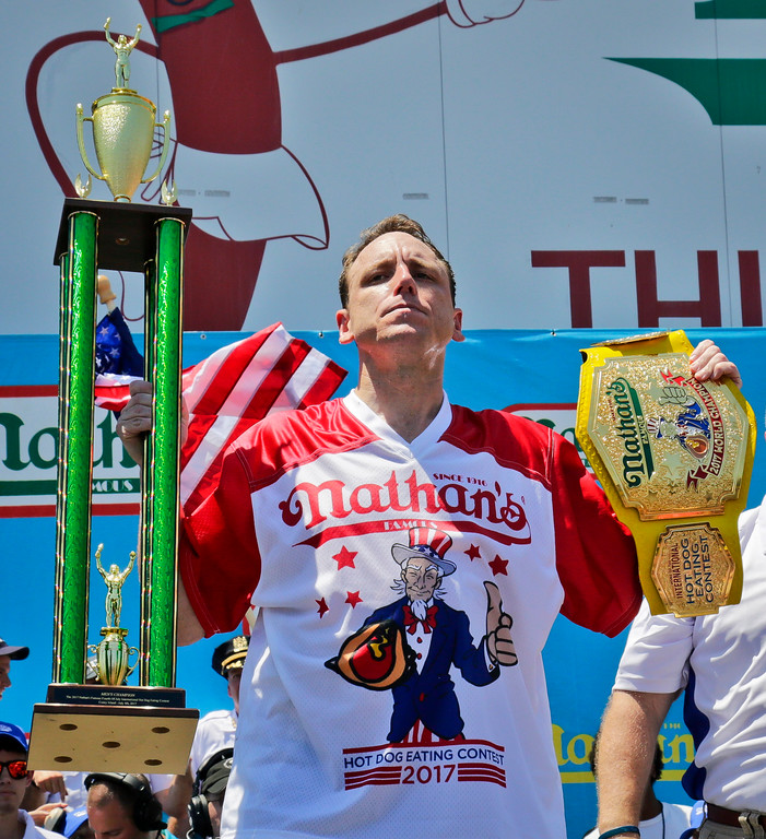 . Joey Chestnut holds his trophies after winning Nathan\'s Annual Famous International Hot Dog Eating Contest, marking his 10th victory in the event, Tuesday July 4, 2017, in New York. (AP Photo/Bebeto Matthews)