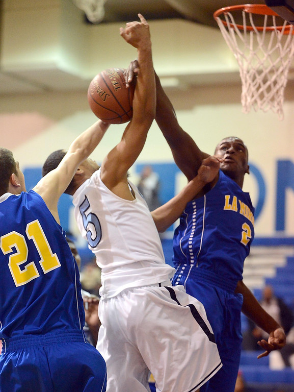 . La Mirada\'s Jarrett Davis (2) blocks a shot from Compton\'s Kevlin Swint (5) in a first round CIF Division 3AAA basketball game Wednesday night in Compton. 20130213 Photo by Steve McCrank / Staff Photographer
