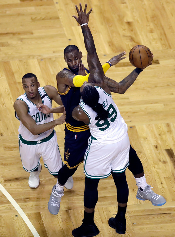 . Cleveland Cavaliers forward LeBron James, center, drives against Boston Celtics guard Avery Bradley, left, and forward Jae Crowder (99) during the second quarter of Game 1 of the NBA basketball Eastern Conference finals, Wednesday, May 17, 2017, in Boston. (AP Photo/Charles Krupa)