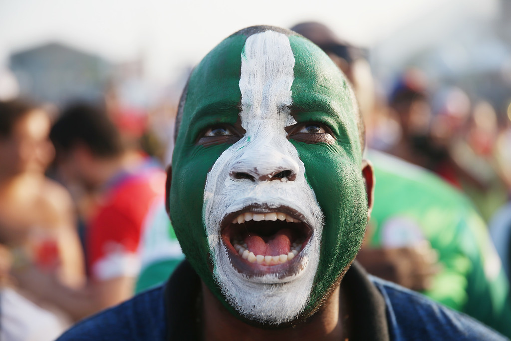 . A Nigerian soccer fan looks on as his team plays against Iran as he watches on a giant screen at the FIFA World Cup Fan Fest on Copacabana beach on June 16, 2014 in Rio de Janeiro, Brazil. The teams are playing on the fifth day of the World Cup tournament.  (Photo by Joe Raedle/Getty Images)