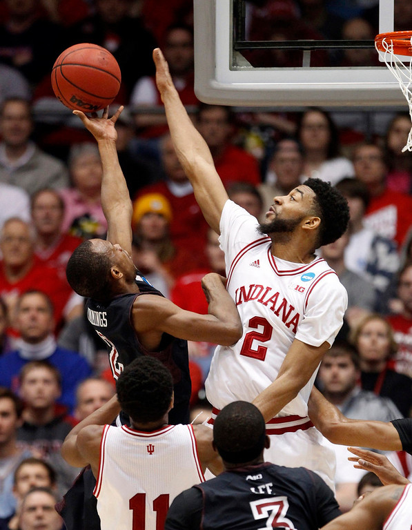 . Indiana Hoosiers forward Christian Watford (R) tries to block the shot of Temple Owls guard Will Cummings (L) during the first half of their third round NCAA tournament basketball game in Dayton, Ohio March 24, 2013.   REUTERS/Matt Sullivan