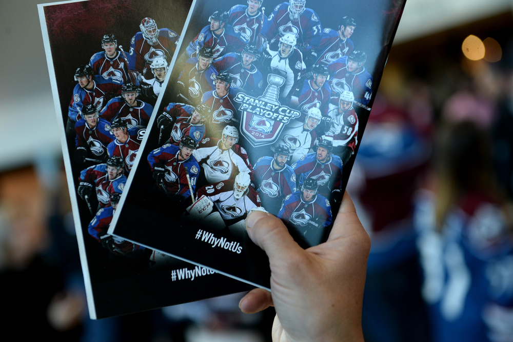 . A fan sells programs before the first period of action. The Colorado Avalanche hosted the Minnesota Wild at the Pepsi Center on Thursday, April 17, 2014. (Photo by Karl Gehring/The Denver Post)