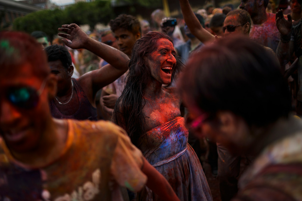 . Revelers of the Holi Festival of Colors throw coloured powders in the air, in Madrid, Spain, Saturday, Aug. 9, 2014. (AP Photo/Daniel Ochoa de Olza)