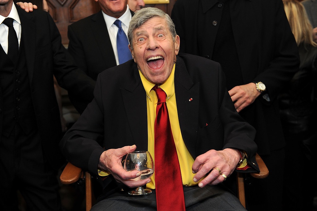 . FILE - In this Friday, April 8, 2016, file photo, Jerry Lewis interacts with the press at the Friars Club before his 90th birthday celebration in New York. A spokeswoman said Thursday, Aug. 31, 2017, that Lewis� friends and family will gather for a private memorial on Monday, Sept. 4, 2017, at the South Point hotel-casino in Las Vegas where Lewis last performed as telethon host. Lewis died Aug. 20. (Photo by Brad Barket/Invision/AP, File)
