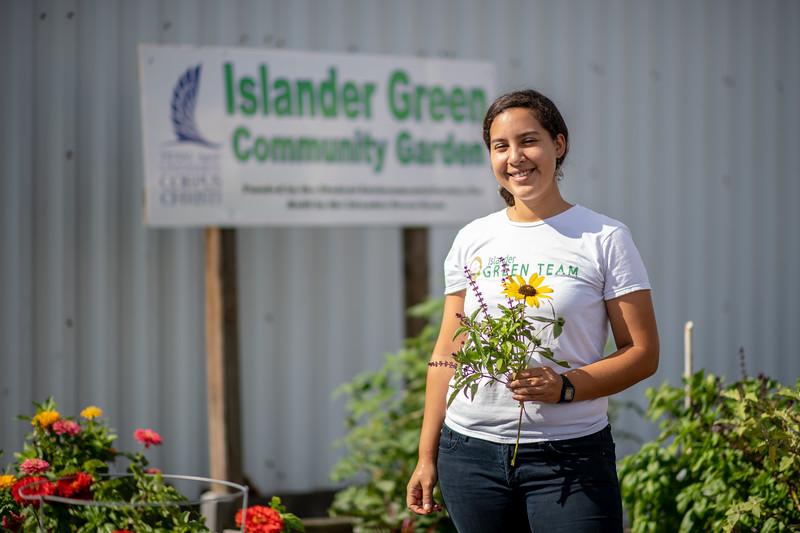 Melissa Zamora stops by the Islander Green Garden.