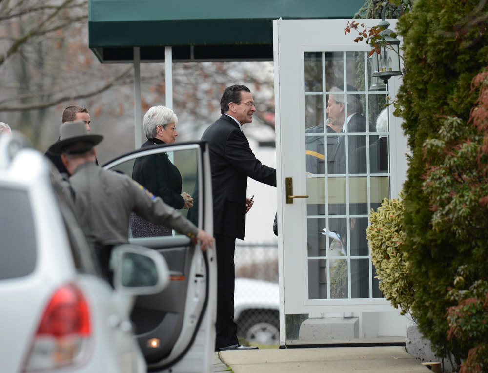 Description of . Connecticut Governor Dannel Malloy(C) arrives for the funeral of Noah Pozner  December 17, 2012 at the Abraham L. Green and Son Funeral Home in Fairfield, Connecticut. Pozner, a six year-old Jewish boy who, along with 19 other classmates and 6 teachers was murdered by a lone gunman December 14 at the Sandy Hook Elementary School in Newtown, Connecticut.  AFP PHOTO / Don  EMMERT/AFP/Getty Images