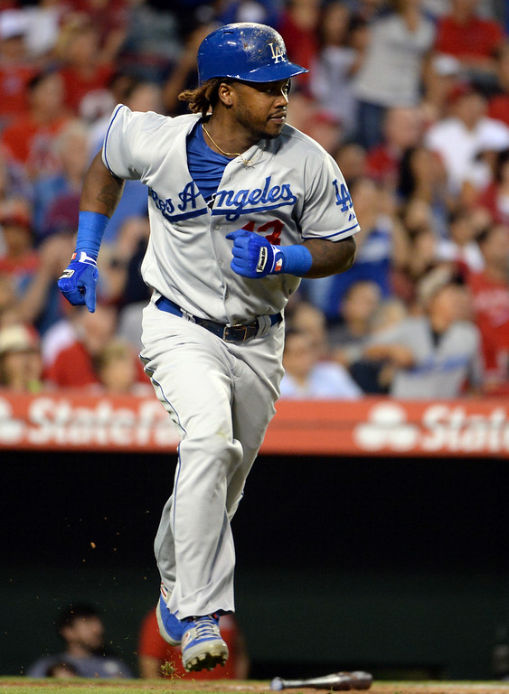 . Los Angeles Dodgers\' Hanley Ramirez watches his two RBI single as Justin Turner and Yasiel Puig (not pictured) scores in the third inning of a baseball game against the Los Angeles Angels at Anaheim Stadium in Anaheim, Calif., on Thursday, Aug. 7, 2014.  (Photo by Keith Birmingham/ Pasadena Star-News)