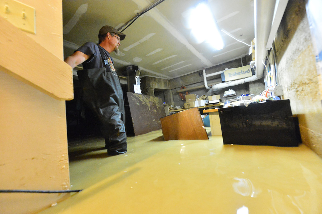 . Sixteen inches of water fills the basement of the Hiking Hut on Saturday, Sept 14, 2013. The business, which was one of the first to reopen after the Mall Fire, found much of their back stock ruined by the flood.  Walt Hester/Estes Park Trail-Gazette