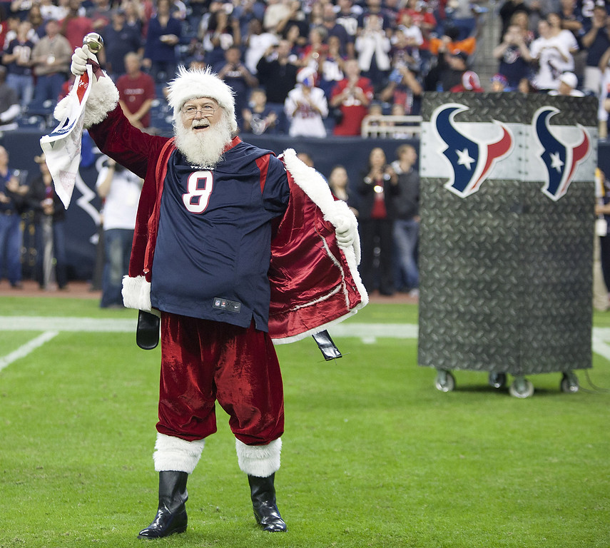 . Santa Claus opens his coat to reveal a Matt Schaub jersey at Reliant Stadium on December 16, 2012 in Houston, Texas. Texans win 29-17 to clinch the AFC South. (Photo by Bob Levey/Getty Images)