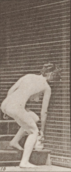 Nude woman descending stairs and stooping