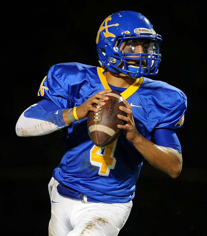 . Bishop Amat quarterback Koa Haynes (C) passes against Alemany in the first half of a prep football game at Bishop Amat High School in La Puente, Calif., on Friday, Oct. 25, 2013.    (Keith Birmingham Pasadena Star-News)
