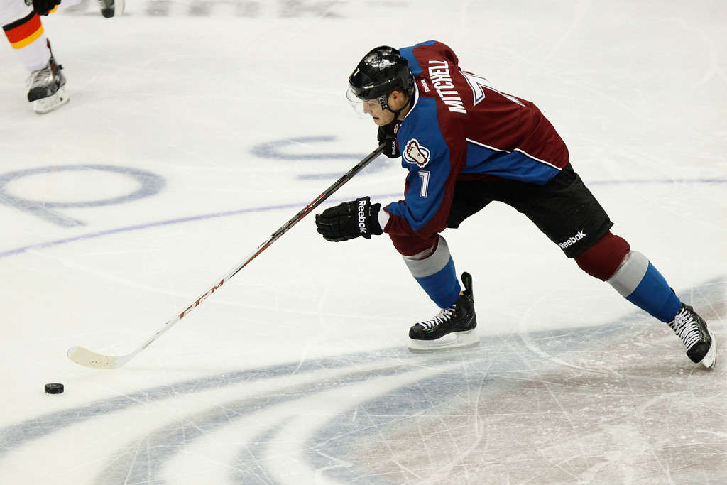 . Colorado Avalanches\' John Mitchell, who scored the NHL hockey game-winning goal, charges downice against the Calgary Flames during the first period on Friday, Nov. 8, 2013, in Denver. The Avalanche won 4-2. (AP Photo/Barry Gutierrez)