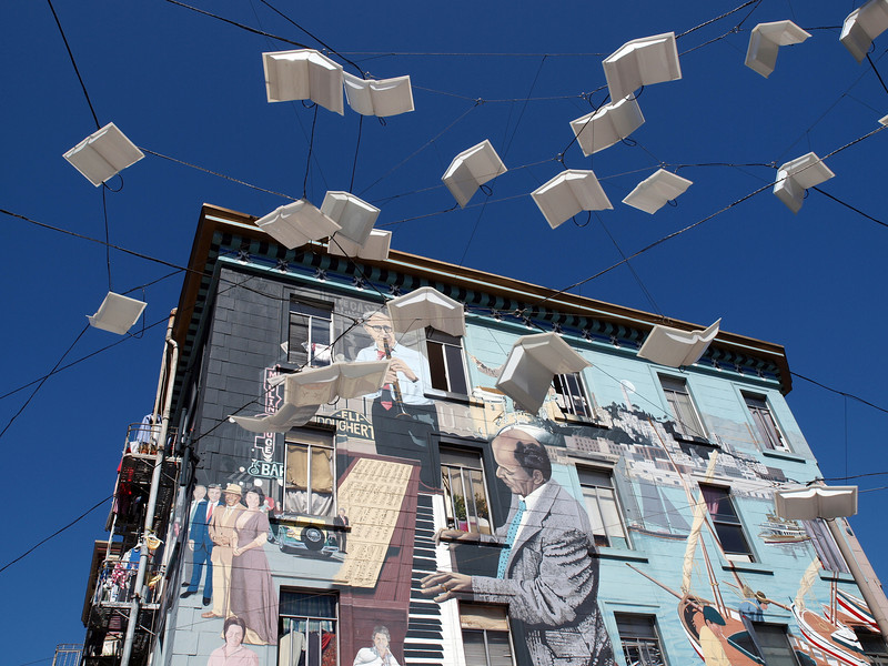 A flock of books takes flight.