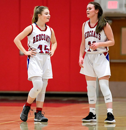 2/26/2019 Mike Orazzi   Staff Berlins Carly Grega (15) and Angela Perrelli (14) during the CIAC 2019 State Girls Basketball Tournament with Plainville at Berlin High School Tuesday night.