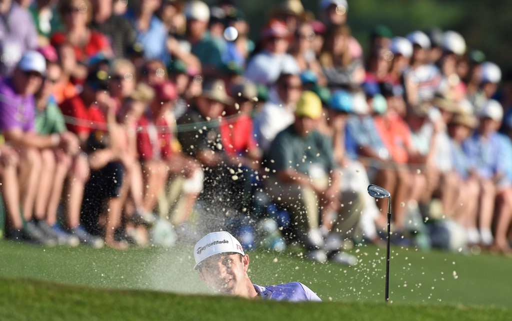 . Dustin Johnson of the US hits out of the bunker at the 18th hole during Round 3 of the 79th Masters Golf Tournament at Augusta National Golf Club on April 11, 2015, in Augusta, Georgia. DON EMMERT/AFP/Getty Images