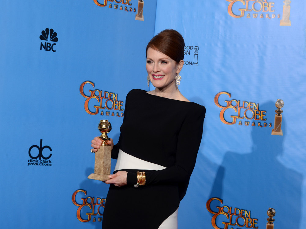 Description of . Actress Julianne Moore poses with Best Actress in a Miniseries Award  in the press room during the 70th Annual Golden Globe Awards held at The Beverly Hilton Hotel on January 13, 2013 in Beverly Hills, California.  (Photo by Kevin Winter/Getty Images)