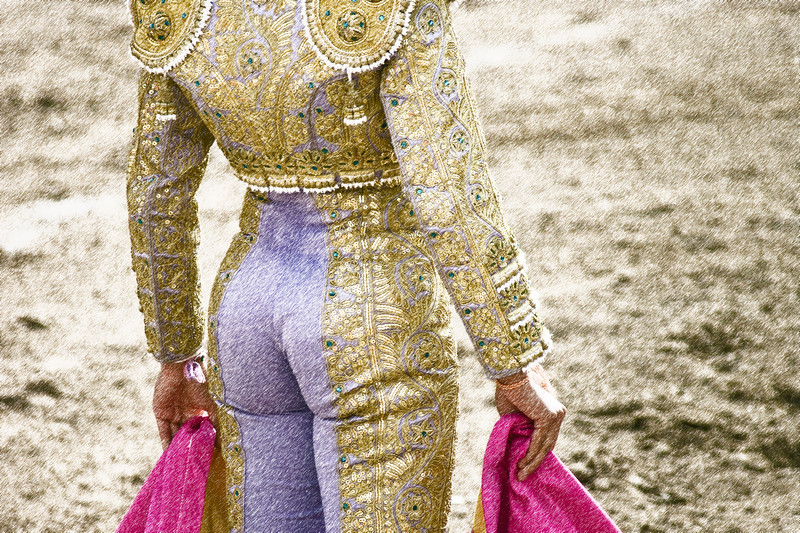 Female bullfighter Hilda Tenorio waits as the bull runs around the bullring