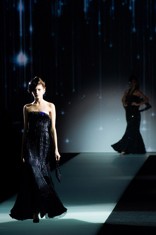 """. Models walk the runway during Giorgio Armani\'s \""""One Night Only New Yorkî fashion show on Thursday, Oct. 24, 2013 in New York. (Photo by Charles Sykes/Invision/AP)"""