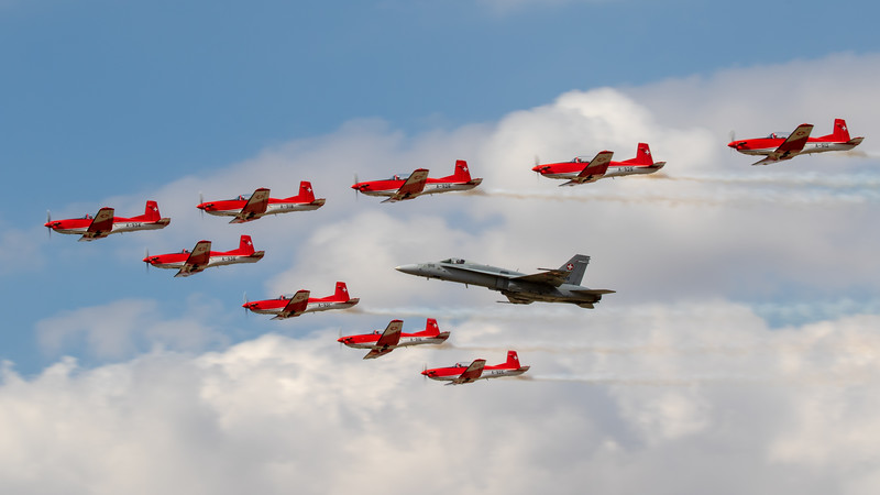 Swiss PC-7 Demo team escorting Swiss F-18
