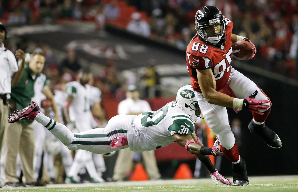 . Atlanta Falcons tight end Tony Gonzalez (88) moves the ball after a catch as New York Jets cornerback Darrin Walls (30) defends during the second half of an NFL football game, Monday, Oct. 7, 2013, in Atlanta. (AP Photo/David Goldman)