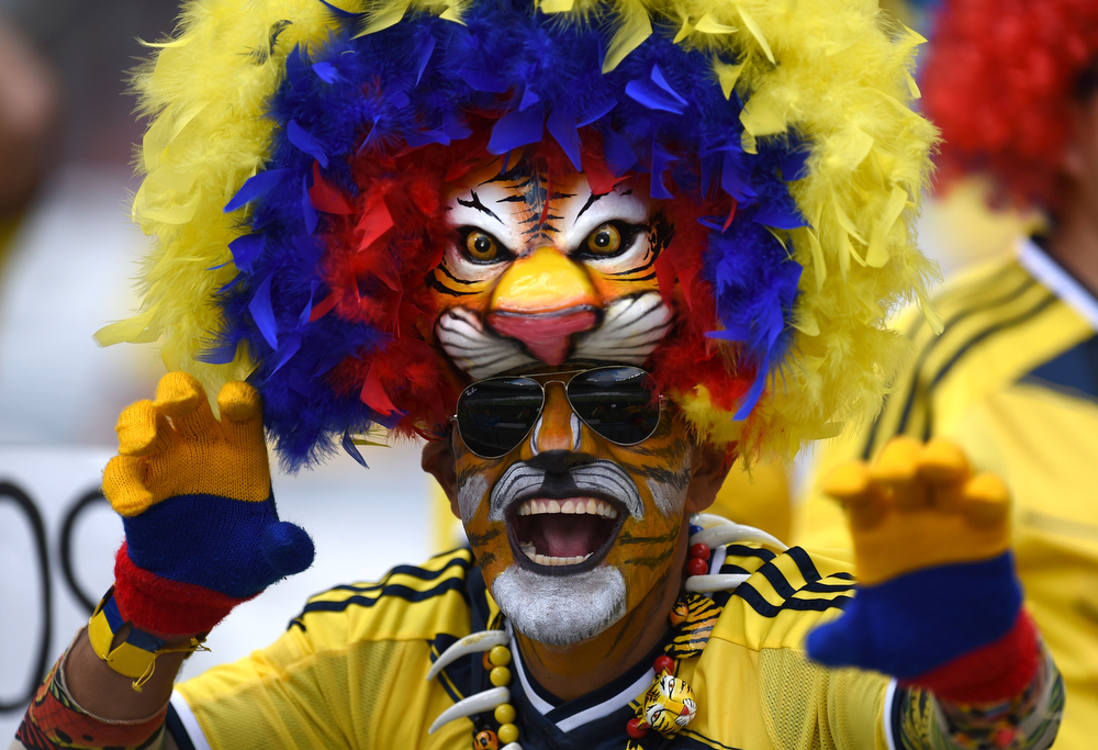 . A Colombian supporter waits for the start of a Group C football match between Colombia and Greece at the Mineirao Arena in Belo Horizonte during the 2014 FIFA World Cup on June 14, 2014.  (PEDRO UGARTE/AFP/Getty Images)