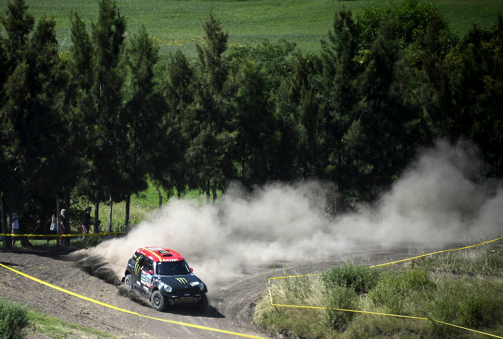 ". Mini driver Joan ""Nani\"" Roma of Spain, and co-pilot Michel Perin of France, races during the first stage of the Dakar Rally 2015 between the cities of Buenos Aires and Villa Carlos Paz, Argentina, Sunday, Jan. 4, 2015. The race starts from Buenos Aires and will pass through Bolivia and Chile, returning to finish in Argentina on Jan. 17. (AP Photo/Franck Fife, Pool)"
