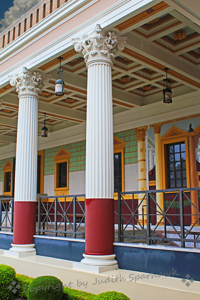 Villa Doorway ~ One view of the Getty Villa, showing decorated columns and painted decorations on the outer corridor, surrounding the outer peristyle garden.
