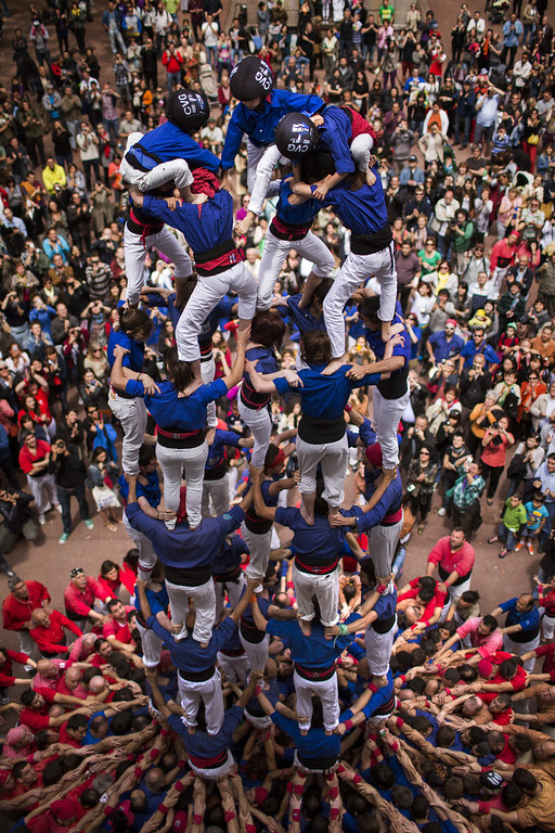 """. Members of the Castellers \""""Vila de Gracia\"""" form their famous human tower called \""""castell\"""" in the Barcelona neighborhood of Gracia, Catalonia, Spain on Sunday May 19, 2013. A \""""castell\"""" is a human tower traditionally built during festivals in many places in Catalonia. At these festivals, several \""""colles\"""" or teams compete to build the most impressive towers they can. (AP Photo/Emilio Morenatti)"""