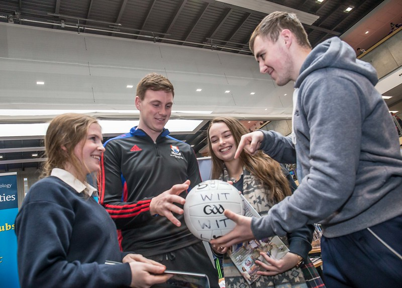 Austin Deasy, Waterford pictured with Charlie Tobin and Ciara Prendergast, Presentation Secondary School, Kilkenny and Eimhin Power, Meath footballer during the Waterford Institute of Technology Schools' Open Day at the WIT Arena. On Saturday, 20 January, WIT is running another open day, the #StudyatWIT Open Day which will have information available on all courses available across WIT's schools of Lifelong Learning, Humanities, Engineering, Science & Computing, Health Sciences, Business. Picture: Pat Moore