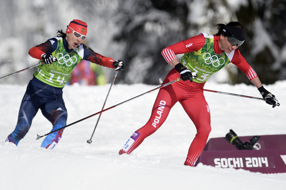 . Russia\'s Julia Ivanova (L) and Poland\'s Justyna Kowalczyk compete in the Women\'s Cross-Country Skiing Team Sprint Classic Semifinals at the Laura Cross-Country Ski and Biathlon Center during the Sochi Winter Olympics on February 19, 2014 in Rosa Khutor near Sochi. (ODD ANDERSEN/AFP/Getty Images)