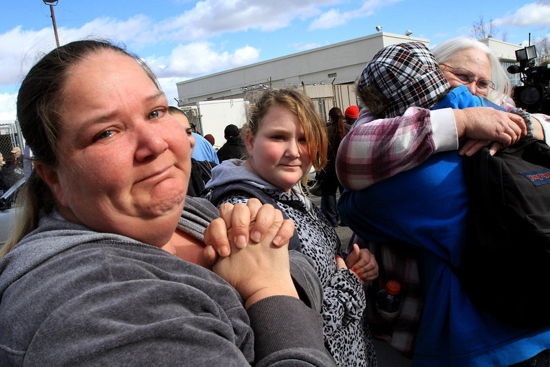 . Teary-eyed mother Mary Jackson, 36, looks on as Jacob Jackson, 15, is hugged by grandmother Sandy Jackson, 57. Parents had spent agonizing hours waiting for their children come out of Taft Union High School in Kern County, California, on Thursday, January 10, 2013, after a student opened fire in a classroom. (Irfan Khan/Los Angeles Times/MCT)