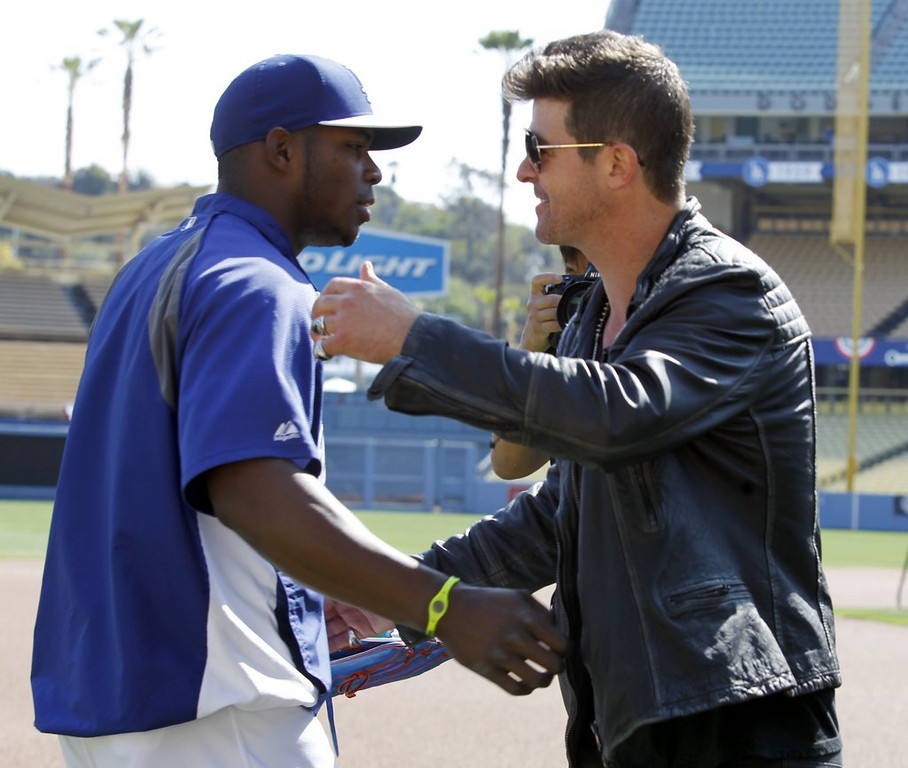""". <p>3. YASIEL PUIG <p>Constantly surrounded by unsavory characters. And that�s just in L.A. (unranked) <p><b><a href=\'http://www.twincities.com/popular/ci_25569424?source=most_viewed\' target=\""""_blank\""""> HUH?</a></b> <p>    (AP Photo/Alex Gallardo)"""