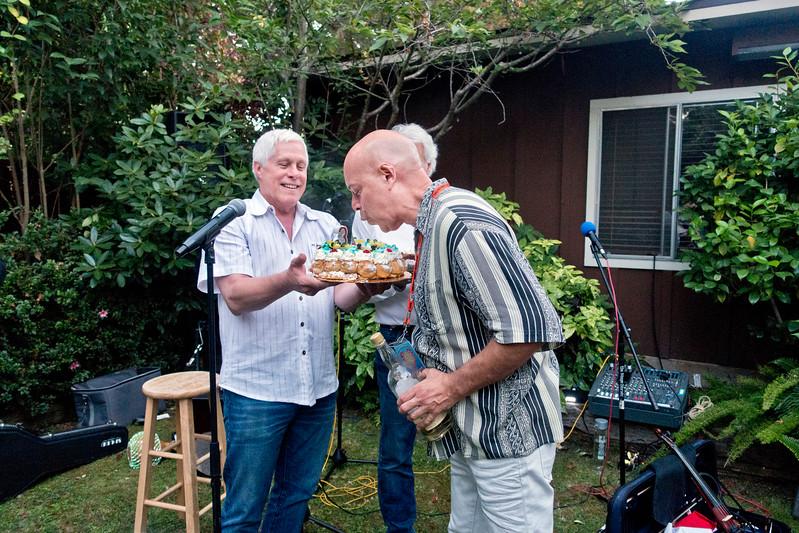 Freddy Clarke, right, receiving birthday cake and blowing out candles  - Freddy Clarke birthday party