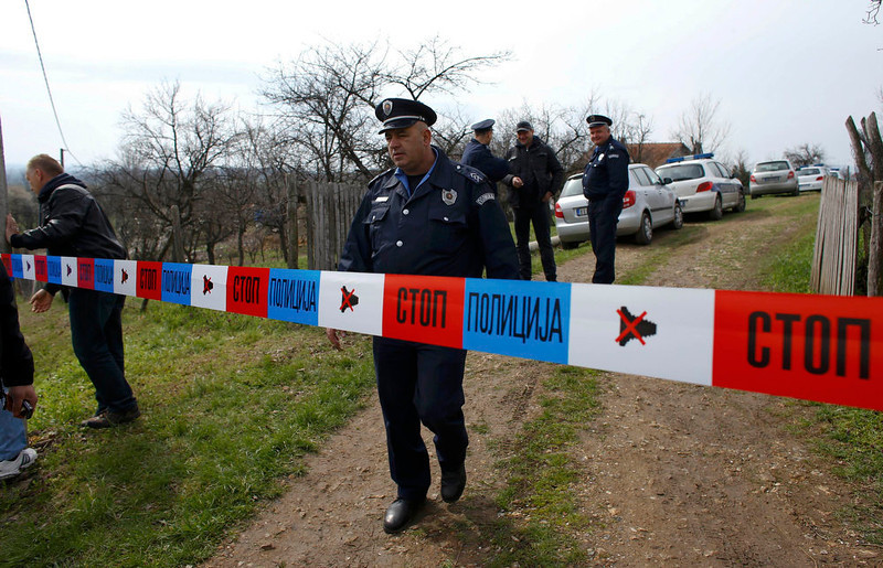 . A policeman stands guard in the village of Velika Ivanca, about 40 km (25 miles) southwest of Belgrade April 9, 2013. A gunman shot dead 13 people, including his mother and son, in an early-morning rampage through a small Serbian village southwest of the capital Belgrade on Tuesday, authorities said. Those killed included a two-year-old child. The gunman, identified by police as Ljubisa Bogdanovic - a war veteran born in 1953 - also shot his wife before turning the gun on himself. Both were in critical condition in hospital, police said.    REUTERS/Marko Djurica
