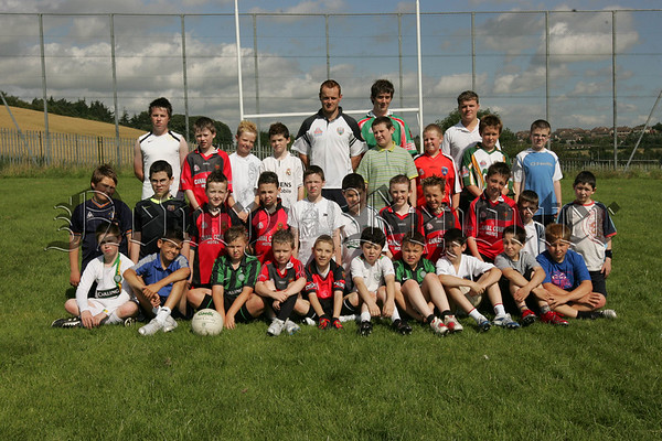 Down Senior Ace Benny Coulter pictured with Year 8 intake pupils at St Joseph's Boys' High School who participated in a summer scheme last week and enjoyed some football coaching from local heroes. Also pictured are past pupils Colin Heaney, Conor Goodman and Daniel Forde. Picture Peter Clarke.