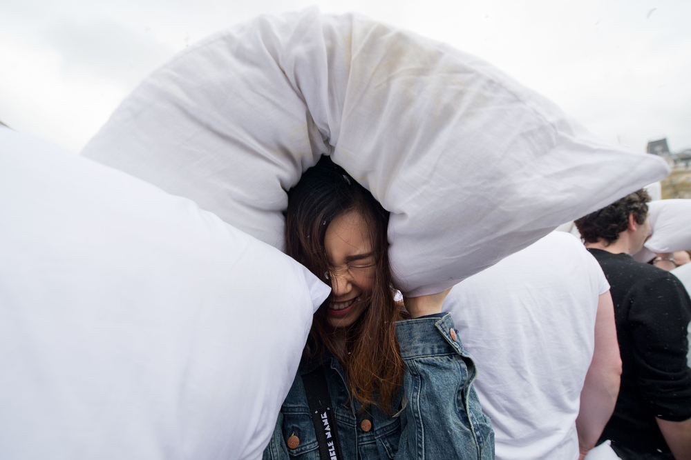 Description of . Revelers take part in a mass pillow fight in Trafalgar Square in central London on April 5, 2014 on International Pillow Fight Day.  The annual event sees groups around the world organize flashmob-style pillow fights in public places.  (LEON NEAL/AFP/Getty Images)